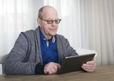 Older man trying to work on tablet pc