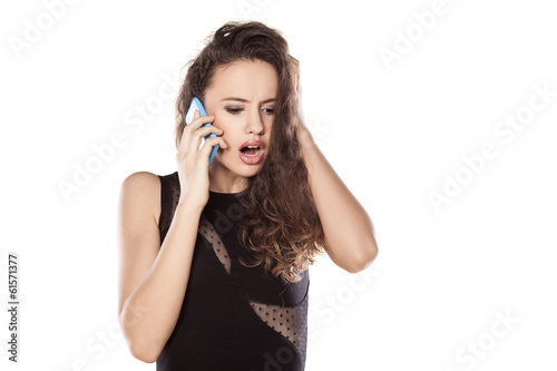 shocked young teenager talking on the phone
