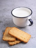 cup of milk with cookies