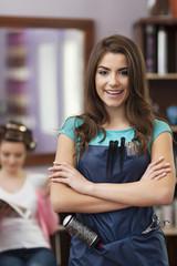 Smiling female owner of hairdresser salon