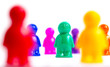 Crowd of colorful toy people on white