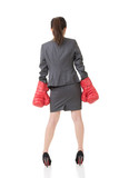 Rear view of Asian business woman with boxing gloves