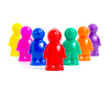 Leadership - colorful toy people group with leader in front of