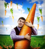 Huge carrot and businessman under blue sky