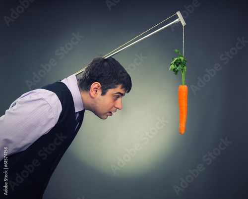 Man and carrot-bait studio shot