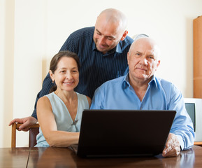 men and woman at home online