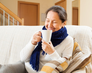 Happy woman in warm scarf