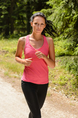 Woman jogging outdoor running on sunny day