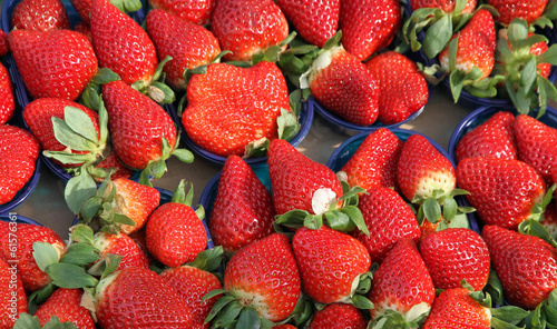ripe strawberry cups for sale at vegetable market