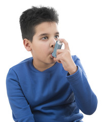 Portrait of cute child using asthma inhaler isolated on white