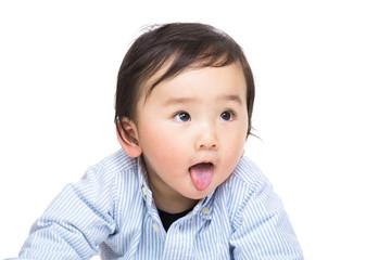 Asian baby showing tongue