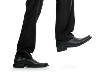 businessman foot stepping