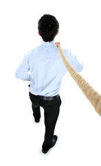 Young businessman pulling a rope while standing not facing the c