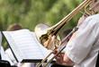 Men playing his trombone - 61578581