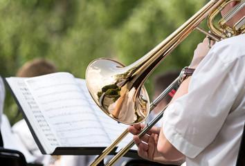 Men playing his trombone
