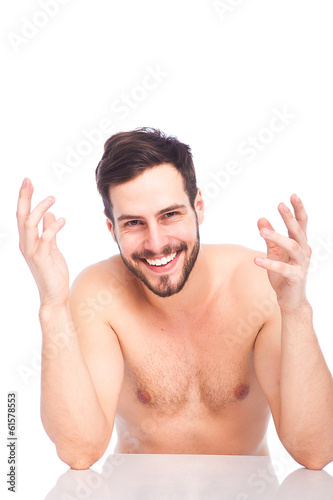 smiling man without shirt