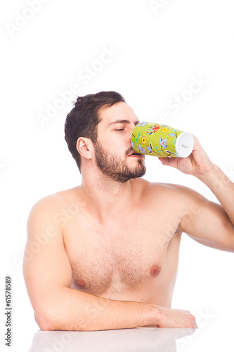 man drinking cuffe without shirt