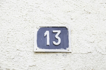 Number thirteen on a wall in a house