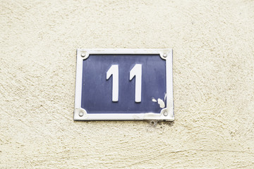 Number eleven on a wall of a house