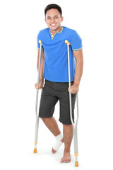 male with broken leg using crutch