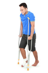 male with broken foot using crutch