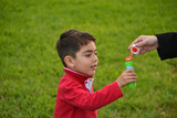 child with soap bubbles in the park