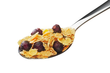 Cornflakes with fruits on the spoon