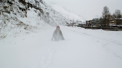 Young girl walking in winter snow and throws up