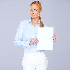 Beautiful elegant blond holding a blank white sign