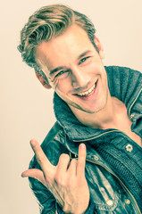 Young handsome Man with Rock and Roll gesture