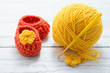 Yellow yarn and crocheted baby shoes - 61581540