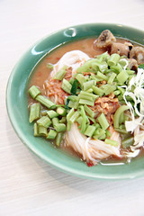 Curry chicken noodles (KHANOM CHIN).