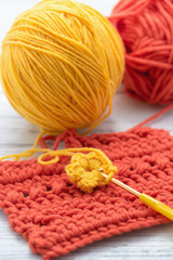 Yellow and orange yarn with crochet hook