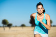 Sporty woman cross country running