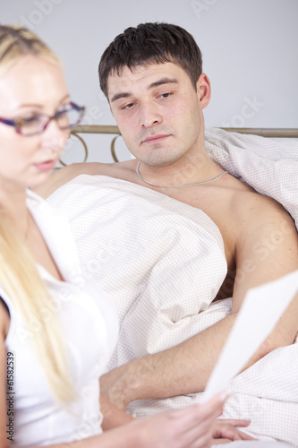Doctor explaining report to male patient