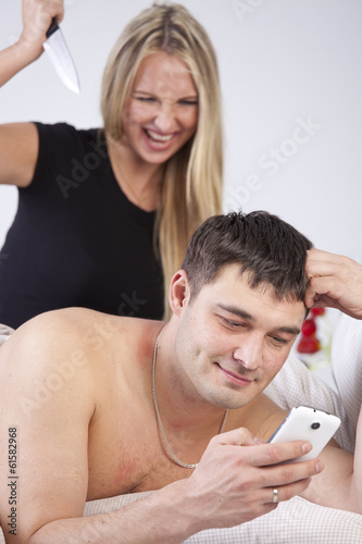 Man is cheating on phone