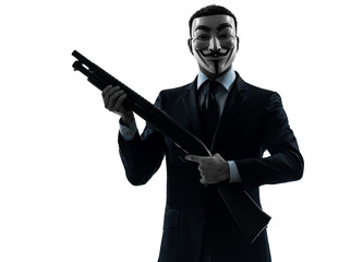 man masked anonymous group memeber holding shotgun silhouette po