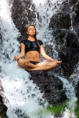 Young woman doing Meditating in Lotus Position