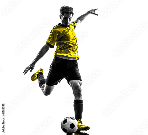 Leinwandbild Motiv brazilian soccer football player young man kicking silhouette