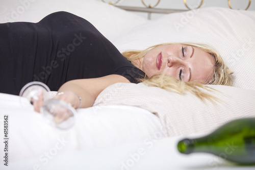 Drunk woman on bed