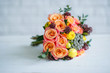 Flower bouquet with orange roses and yellow ranunculus