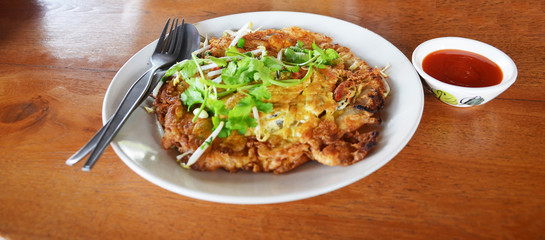 Oysters fried in egg batter or Oyster omelette