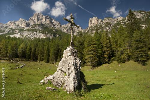 Cross on mountain, Dolomites Italy.