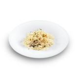 Risotto - rice cooked with broth and sprinkled with grated chees