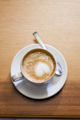 Coffee cup with milk on the table