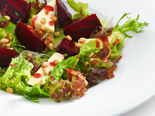 Fresh vegetarian gourmet salad with baked beetroot and cheese se