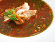 Hot delicious tomato soup with fish and rice served with leek an