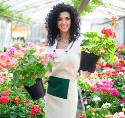 Woman holding flowers in a greenhouse