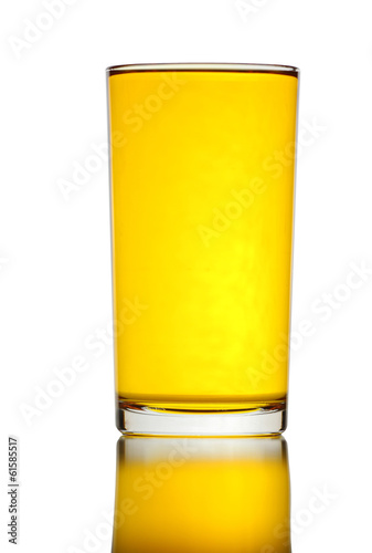 Glass of yellow water isolated.