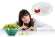 diet, young woman choosing between fruits and sweets. weight los